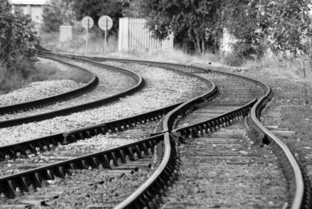 Black and white image of deserted railway track