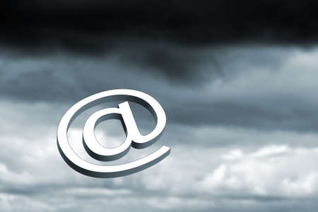 Email symbol over dark stormy black clouds  photo
