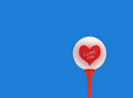 golf ball on tee: Close-up of valentine heart overlaid onto golf ball
