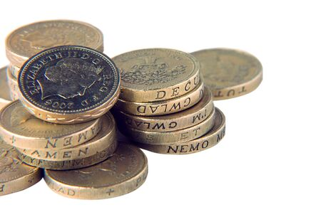 Close-up of UK pound coins over white Stock Photo - 4323170