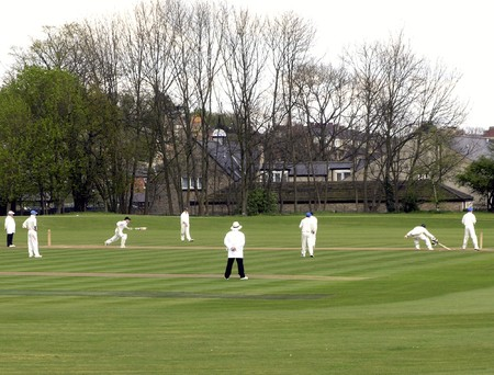 cricket game: Local team players enjoying English game of cricket