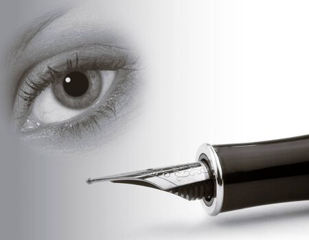 Eye abstract overlaid over close-up of fountain pen photo