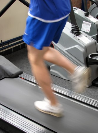 Man running on treadmill in gymnasium Stock Photo