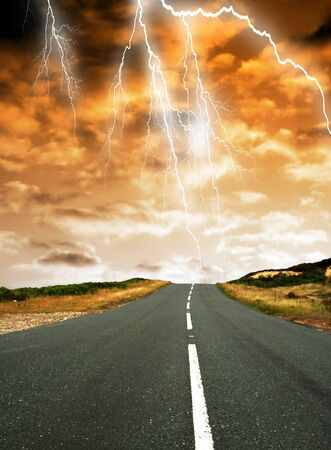 Conceptual image showing road leading into clouds with lightning effect