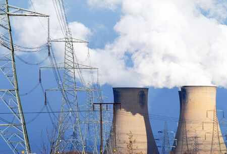 Telephoto view of coal power station cooling towers and electricity pylons Stock Photo - 4623545