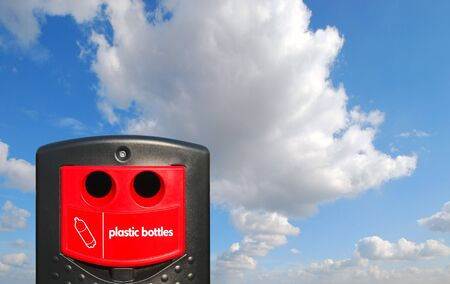 throwaway: Plastic bottle recycling bin over blue cloudy sky