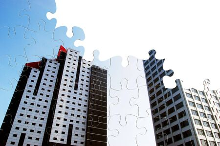 Two office blocks overlaid onto jigsaw pattern photo