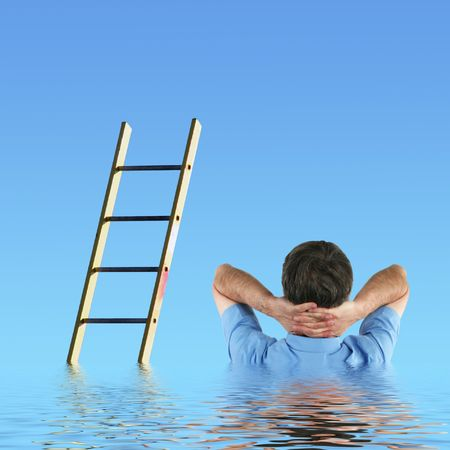 inactive: Inactive man daydreams of climbing the promotion ladder Stock Photo