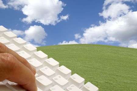 luscious: Conceptual image of male using keyboard in luscious landscape