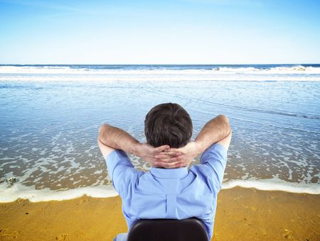 Happy executive dreams of ideal beach vacation photo