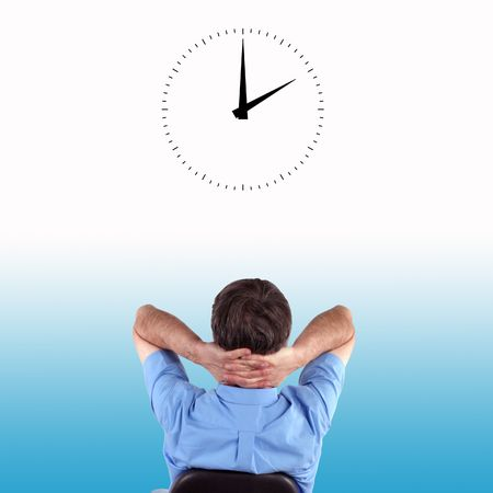 Office worker watches clock as time goes by photo