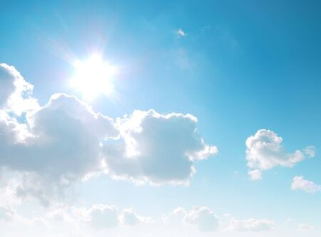 the flair: Cloudy blue sky with sun and lens flair Stock Photo