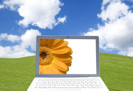 Close-up of laptop computer in rural setting photo