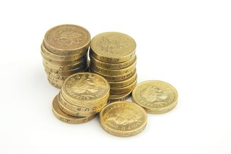 Close-up of stack of UK pound coins on white Stock Photo