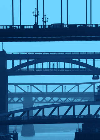 Telephoto view of NewcastleGateshead bridges with blue color added. photo