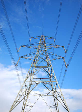 Wide angle view of electricity pylon against blue cloudy sky photo