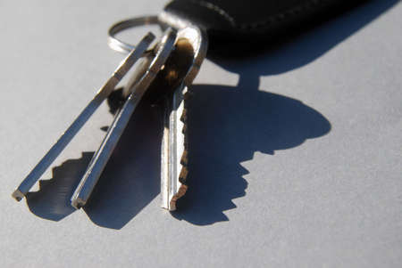 Close-up of house keys on grey card background photo