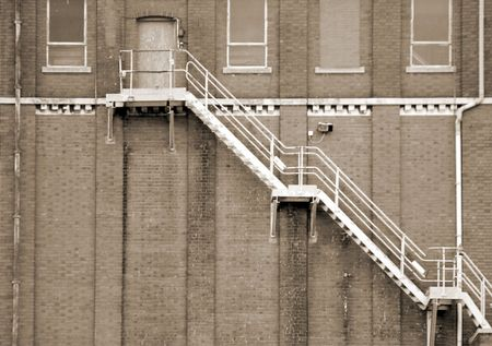 Sepia toned image of fire escape on brick building Stock Photo - 4980929