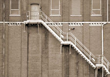 Sepia toned image of fire escape on brick building Stock Photo - 4980929