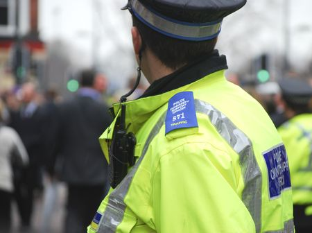policeman: Police community support officer in busy high street Stock Photo