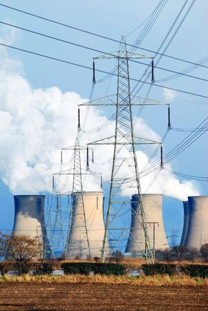 Telephoto view of coal power station cooling towers and electricty pylon Stock Photo - 5112110