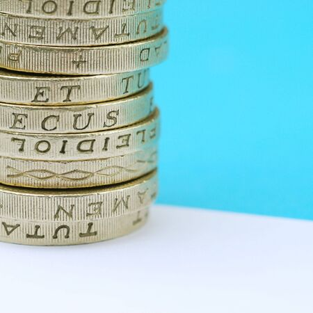 Close-up of stack of UK pound coins photo