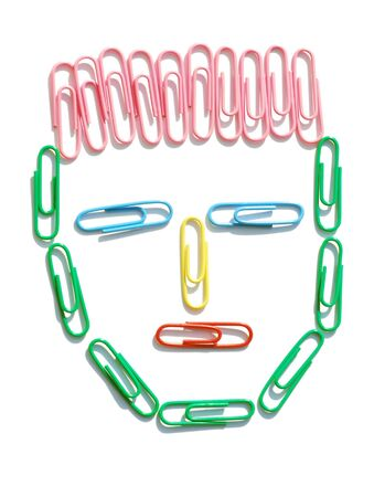 Colored paperclips in the shape of a mans head Stock Photo - 5174664