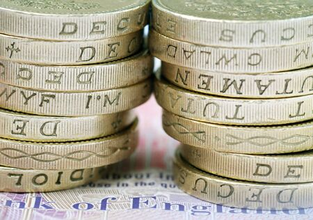 Close-up of stack of UK pound coins on bank note Stock Photo - 5174670