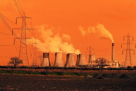 cooling tower: Wide angle view of coal power station with red color for effect