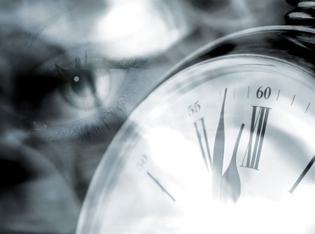 Closeup of clock overlaid with eye abstract photo
