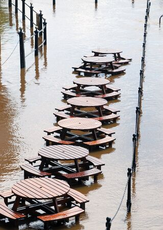 ouse: Abandoned tables during flooding of York River Ouse.