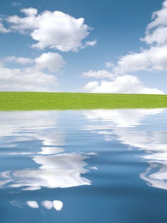 Luscious green grass and cloudy blue sky with simulated water reflection Stock Photo - 5265038