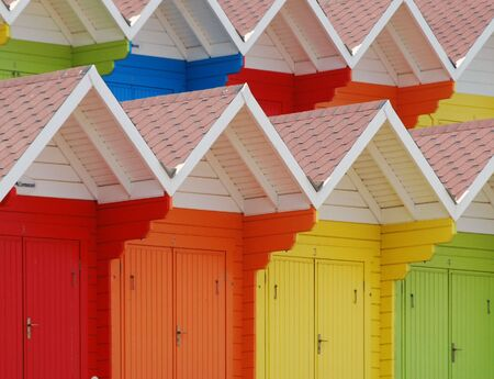 Rows of colorful beach huts in Scarborough, UK