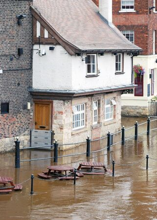ouse: Flooded waters from River Ouse surround riverside pub in York. Stock Photo