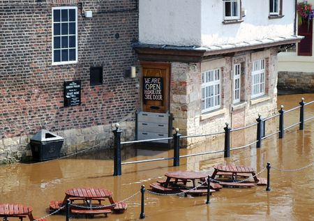 ouse: York River Ouse floods the outside of public bar Stock Photo