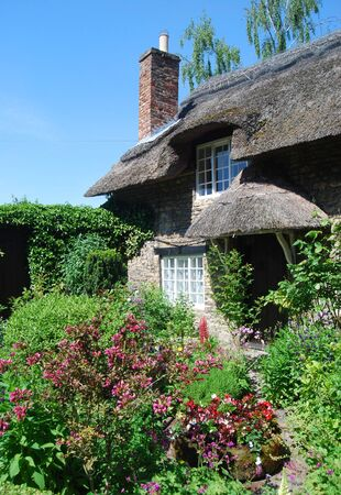 Postcard view of English thatched cottage garden photo