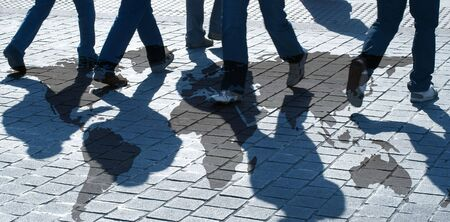 hectic: View of silhouetted people walking over world map