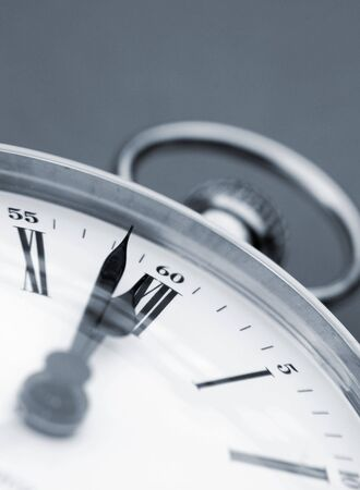 Close-up of clock face over green background photo