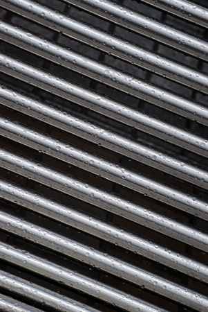 cling: Rain drops cling to stainless steel tubes