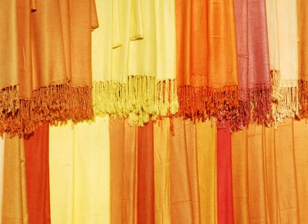 scarves: Womens scarves for sale on traders stall Stock Photo