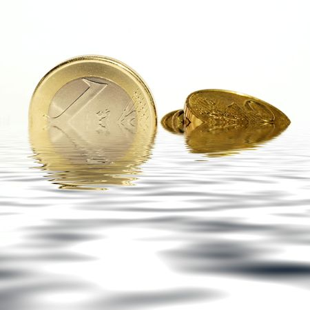 sinking: Finance concept showing Euro coins sinking. Stock Photo