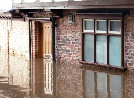 ouse: View of fooded door and window. River Ouse, York.