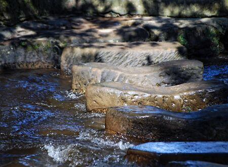 stepping: Telephoto view of stepping stones crossing river