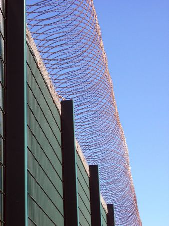 Prison fencing showing coiled razor wire photo