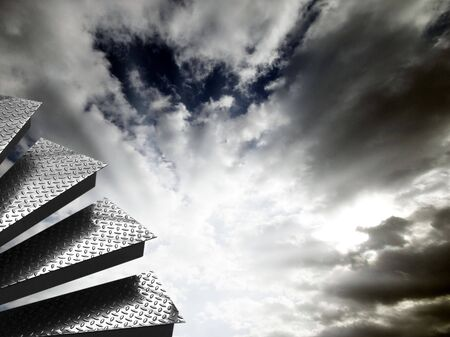 sky  dramatic: Metal steps against dramatic cloudy sky Stock Photo