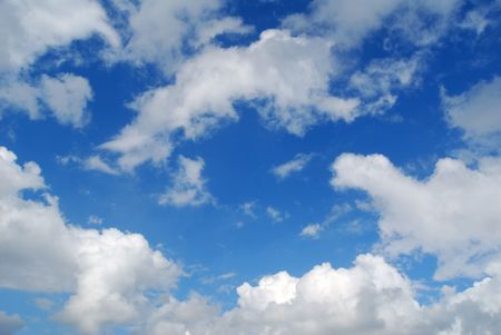 random: Section of blue sky with puffy clouds