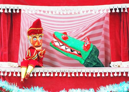 puppet show: Closeup of punch and judy puppets showing puch and crocodile. Stock Photo