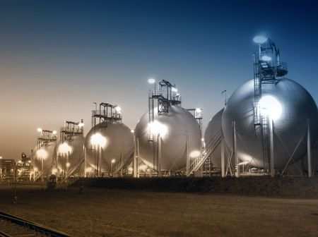 View of fuel storage depot taken at night and dual toned blue and sepia. Stock Photo - 6401922