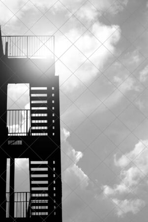 Silhouette Of Fire Escape Stairs On Exterior Of Building Stock Photo    6446551