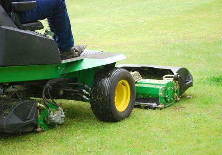 Man cutting grass using motorised grass cutter
